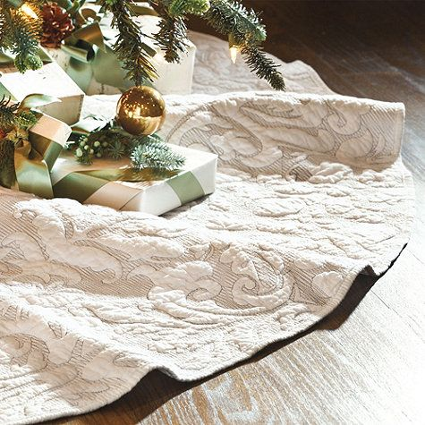 Encircle your tree with the elegance of our Damask Tree Skirt. Zigzag stitching works like etching to bring out the snow white damask, echoing the puffed texture of a classic matelasse