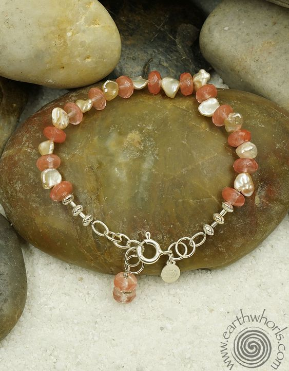 http://earthwhorls.com/collections/bracelets/products/1651sb  Handmade, one of a kind, natural stone, gemstone and silver, unique jewelry designs by EarthWhorls.  Free shipping and gift Wrap