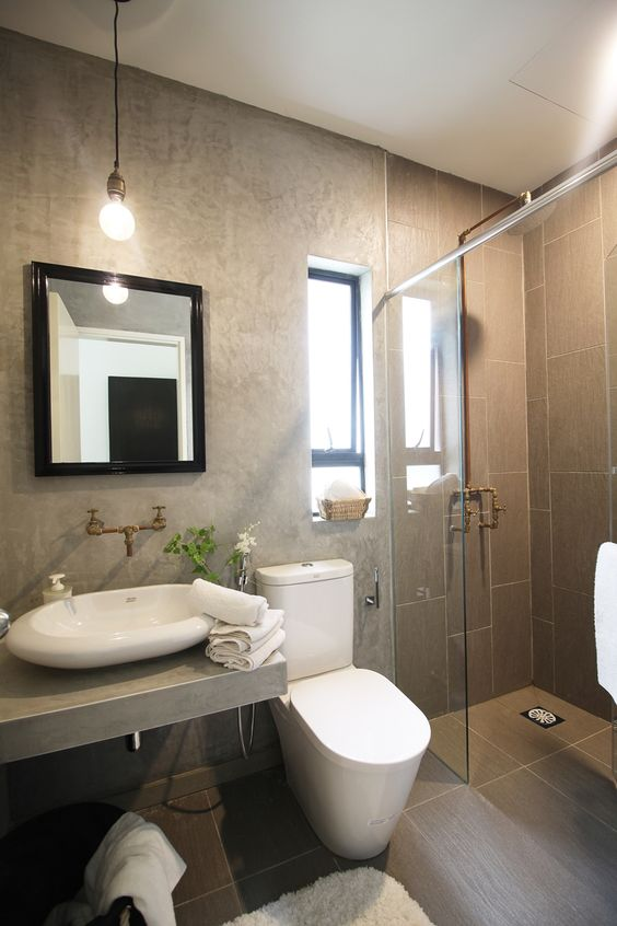 Raw cement feature wall design in this industrial styled for Bathroom ideas malaysia