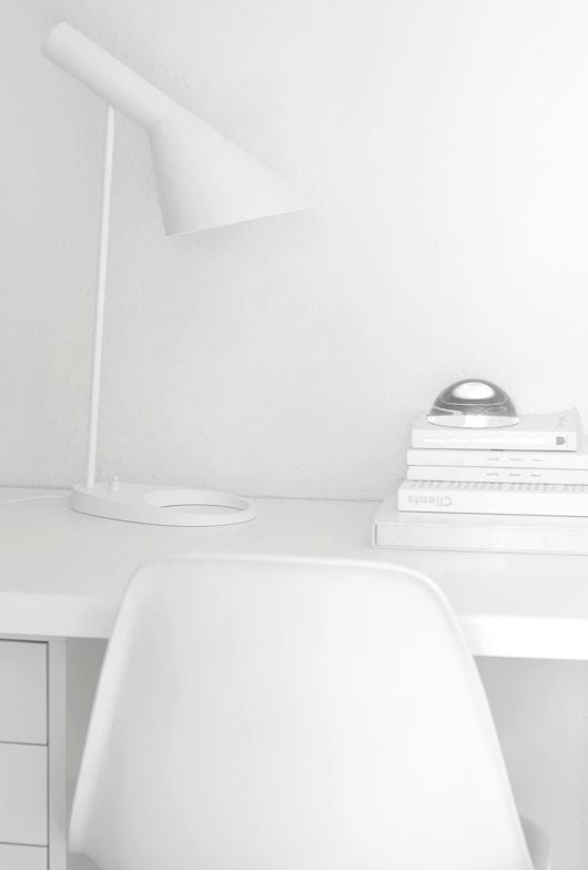 Arne Jacobsen table lamp a true design classic. Tranquil working space