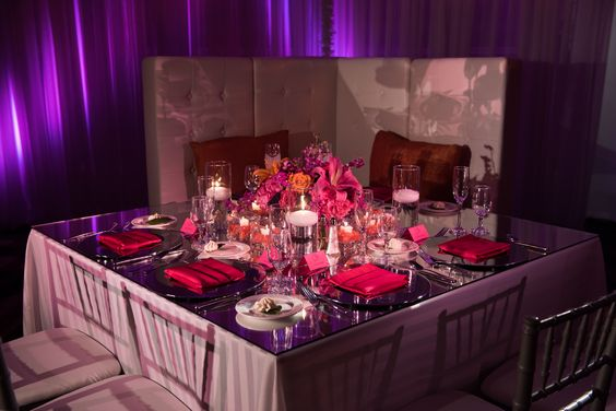 Gorgeous wedding tablescape with grey, purples, oranges, and reds.  Complete with an elegant napkin fold and soft seating.  Photo by New Image Photography at the Hilton Akron/Fairlawn Hotel and Suites