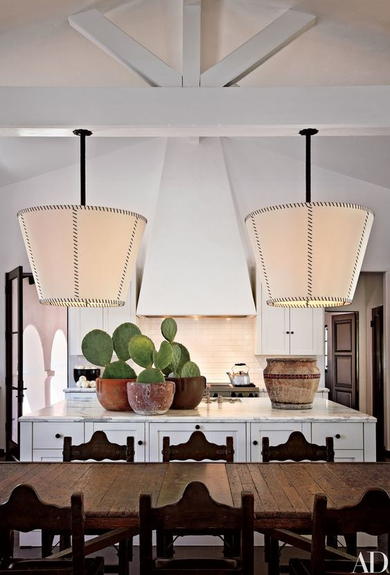 "Shadley came up with the idea of the kitchen's inverted-lampshade fixture on his first project with Keaton. ""It works well, directing light down and also giving off great indirect light,"" he says. Viking range and hood, at Abt.com 