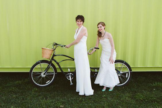 Same sex wedding, brides on a tandem bicycle