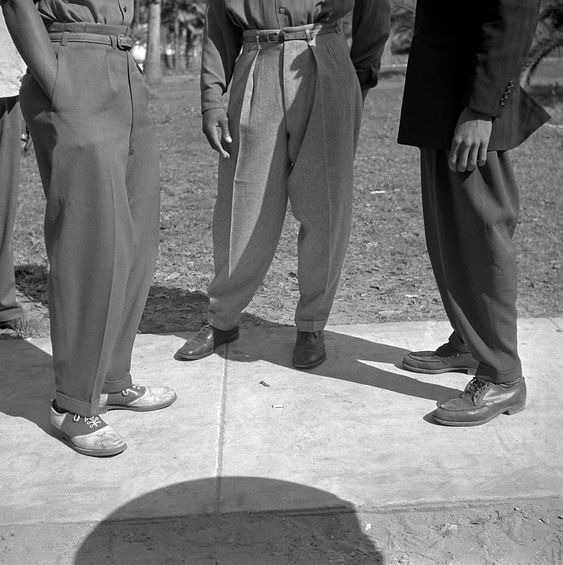 The creation of the zoot suit can be traced to Harlem in the mid to late 1930s. Initially an African American youth fashion, closely connected to jazz culture, the zoot suit was co-opted by a generation of Mexican American youth. The oversized suit was both an outrageous style and a statement of defiance. Zoot suiters asserted themselves in the face of widespread discrimination. At the dawn of WWII, the suit was condemned by the U.S. government and over time the suit was seen as unpatriotic.