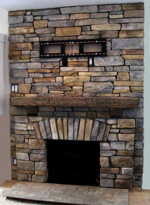 Stacked stone fireplace and rustic wood mantle you for Rustic stone fireplace