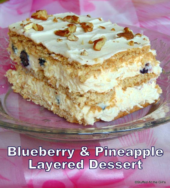 Stuffed At the Gill's: Blueberry & Pineapple Layered Dessert quickly comes together with berries and crushed pineapple folded into a mixture of instant pudding, cream cheese and whipped cream.  The pudding mixture is then sandwiched between layers of graham wafers and refrigerated overnight to produce cake-like layers with a creamy delicious filling.  Perfect to serve at family gatherings or potlucks. #Blueberries #Pineapple #Dessert #InstantPudding #CreamCheese #WhippedCream #Nuts