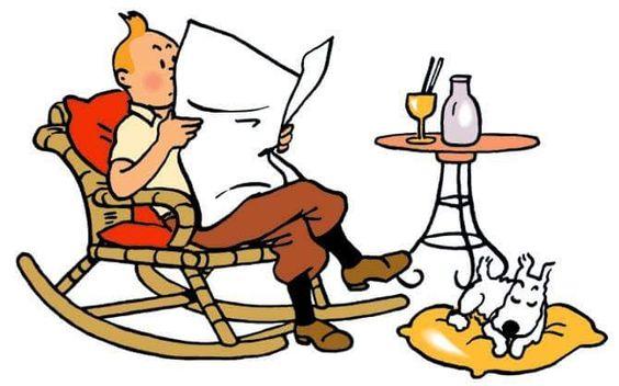 くつろぎながら新聞を読むタンタンの画像