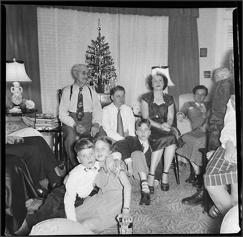 Black People Decorating For Christmas 1950s vintage black and white photo christmas tree family men