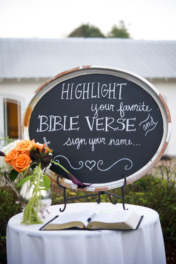 Katie + Brooks had several guest books including one where they had guests sign their favorite Bible verse. Photo by Alisha Crossley Photography: