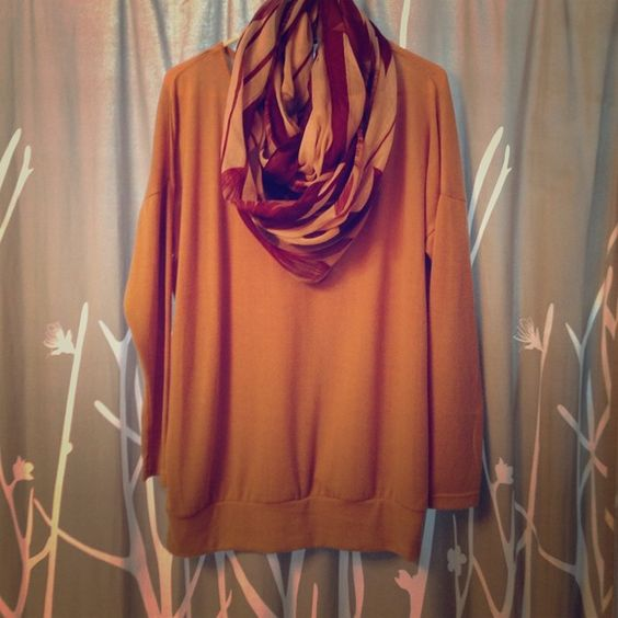 NWT. Caramel knitted sweater/top. Caramel knitted sweater top. Material is super comfy and stretchy. I have this in 2 other colors - I wear them with a scarf and off to work I go! Sweaters
