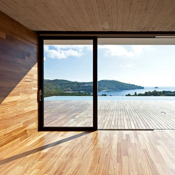 Love how the floor boards extend from inside to outside