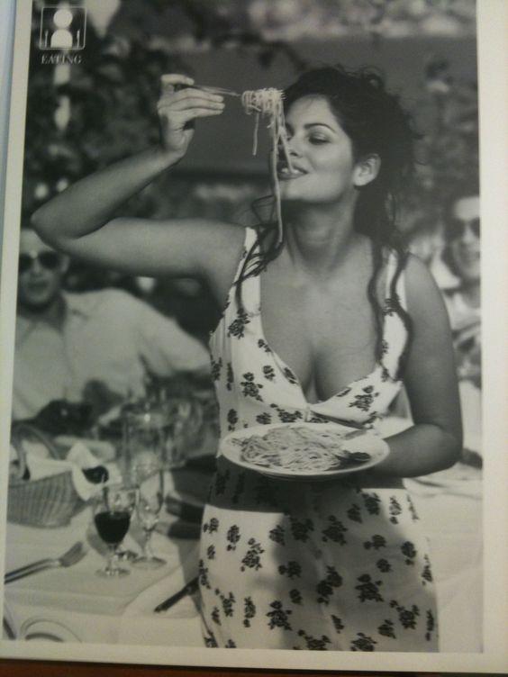The most beautiful and iconic woman: an Italian beauty enjoying her spaghetti!