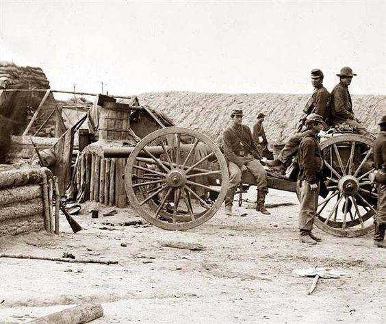 Federal soldiers removing artillery from Confederate fortifications