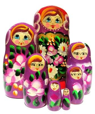 Beautiful flowers are featured on this hand painted set of 7 Russian purple Maria nesting dolls. Available for sale in limited stock. Buy now and save.