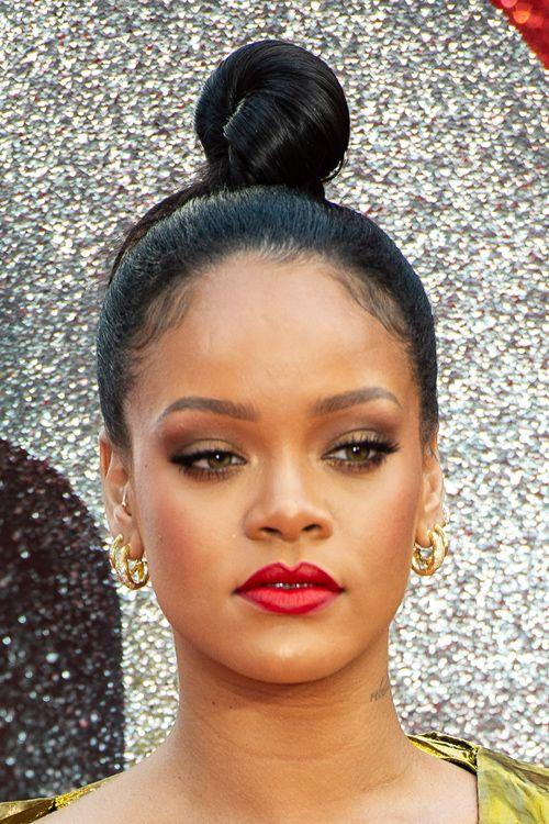 Rihanna Straight Dark Brown Bun Hairstyle Steal Her Style Rihanna Hairstyles Hair Styles Bun Hairstyles
