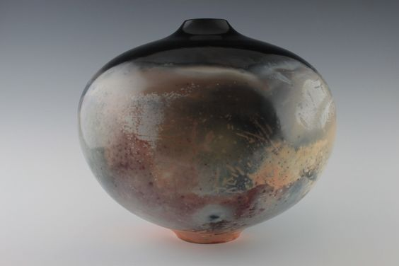 BBQ Pot, Porcelain, terra sigged, bisqued, and bbqed with salt, copper carb, cow patties and wood.