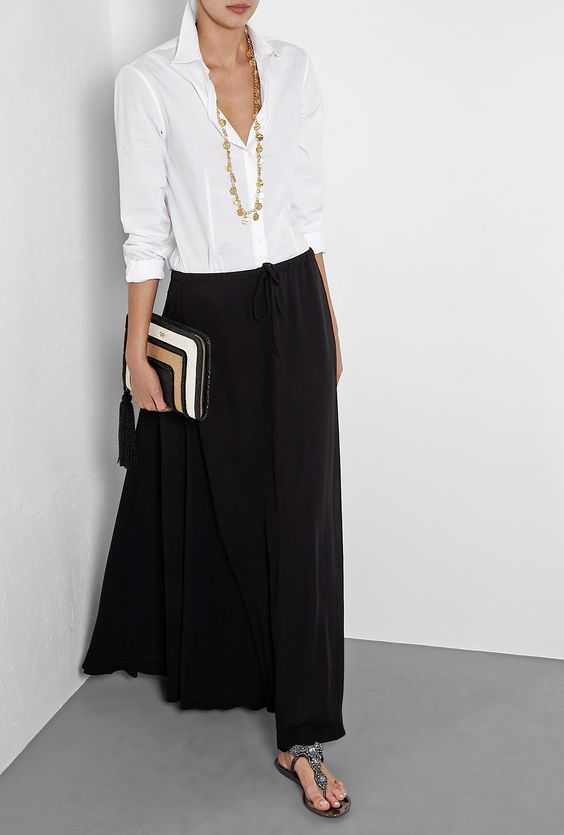 Relaxed white shirt, black maxi and sandals.... easy style ck...good for a hot day, you can spritz with water to keep skirt cool and white top looks great: