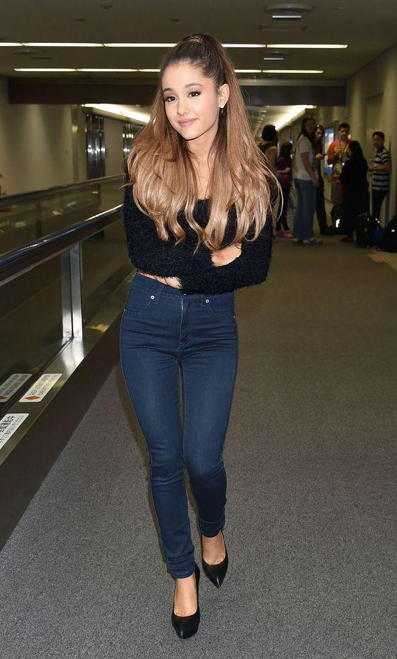 Ariana Grande street style: Black fuzzy crop top , Rag& Bone super skinny blue jeans and YSL Janis pumps in black