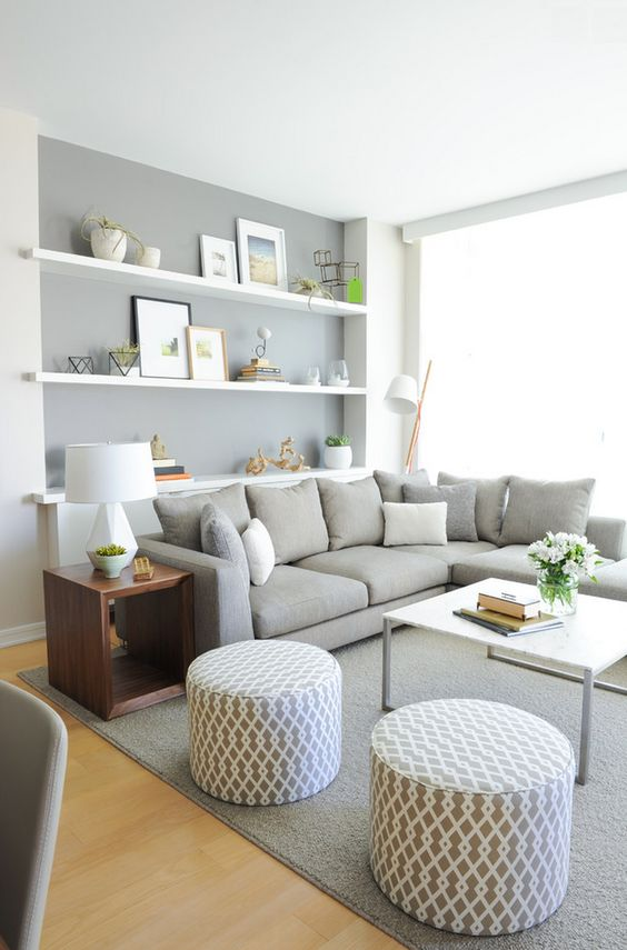 Cute cozy gray living room | gray and white patterned ottomans | gray couch | gray walls | gray rug: