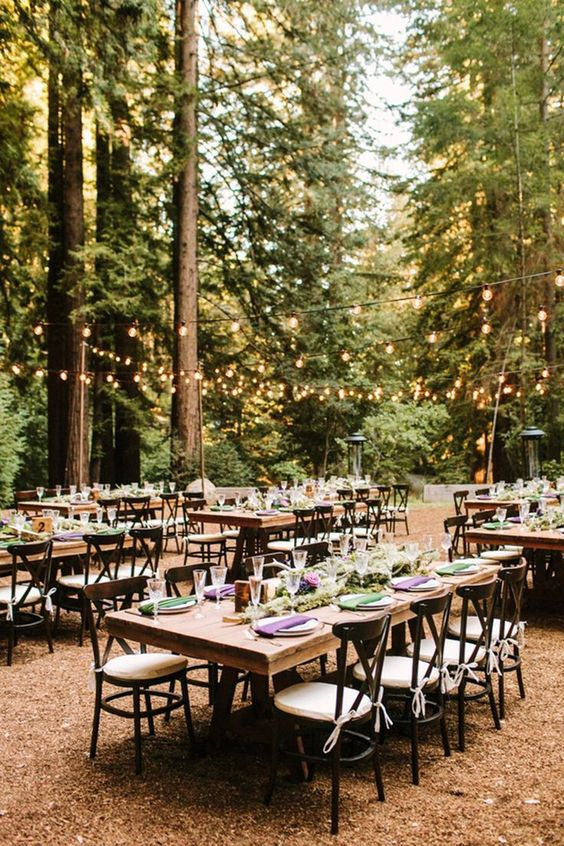Launch yourself into the magic of this serene Redwoods forest wedding. Love this wedding dinner outdoor space with seating in the woods with string lighting  outdoor weddings #outdoor  - Outdoor weddings Launch yourself into this enchanted forest wedding