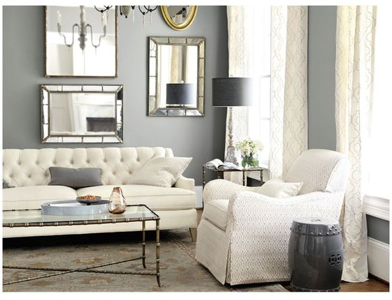 Living room grey walls with gold and silver accents white furniture