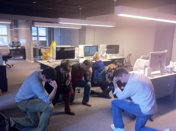 """Some of the employees """"Tebowing"""" at the office!"""