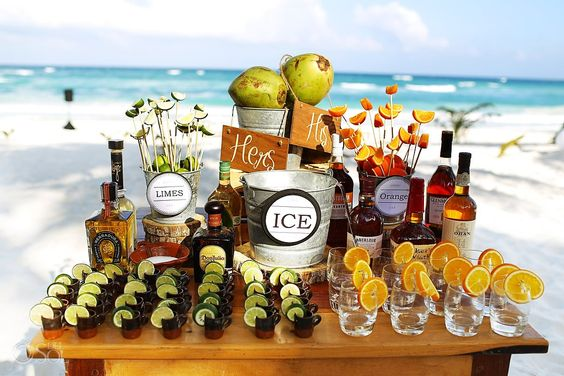 Wedding Tulum Akiin Beach Club, tequila and mezcal on the beach, great table set up with delicious refreshments that are typically Mexican!   Mexico wedding photographers Del Sol Photography: