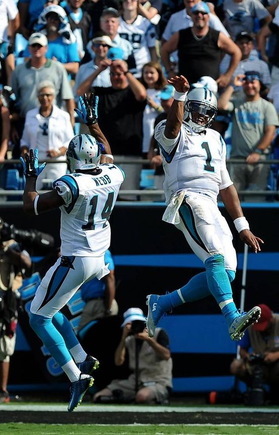 Carolina Panthers quarterbacks Joe Webb, left, and Cam Newton, right, celebrate a touchdown pass reception by wide receiver Philly Brown during fourth quarter action at Bank of America Stadium in Charlotte, NC on Sunday, September 20, 2015. The Panthers defeated the Texans 24-17.