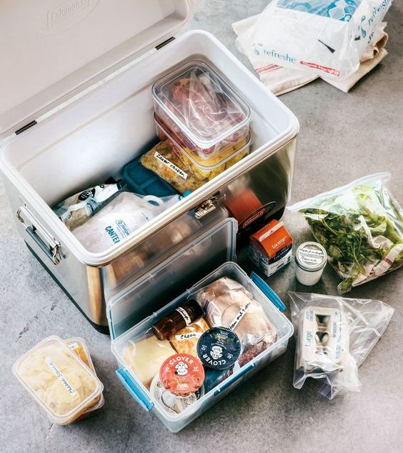 When it comes to food during a camping trip, your goal is for is to stay cold, organized, dry, and unsquished, with no massive ice melt by day 3. And don't forget that bringing two coolers—one for food and one for drinks—is ideal if you have the space. Here's how to pack a cooler like a pro!