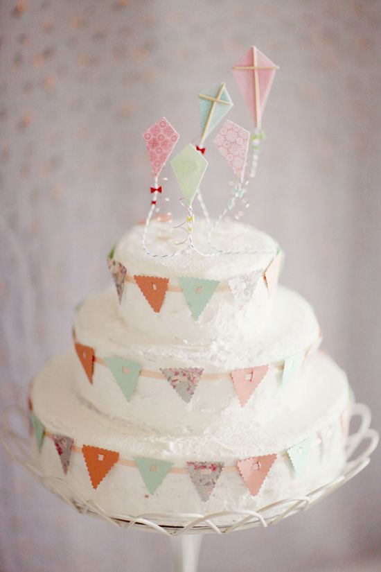 Up, up and away! - so sweet for a small wedding. Could make the round the cake bunting with colourful fondant even :)