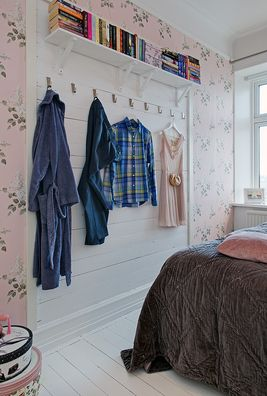 Love how these clothes are hung in the bedroom