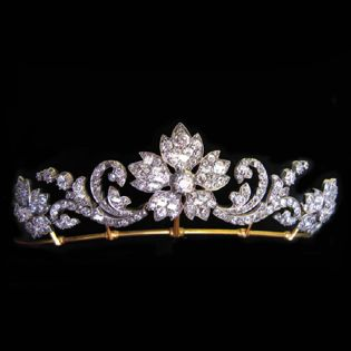 Victorian Diamond Floral Tiara. Bentley & Skinner, London. The tiara comprises three diamond flower heads linked by diamond scroll work of a foliate design, encrusted throughout with old brilliant-cut diamonds, estimated to weigh a total of 15 carats, all set in silver to a yellow gold mount, with detachable diamond-set necklace fittings and tiara frame, gross weight 32.45, circa 1870