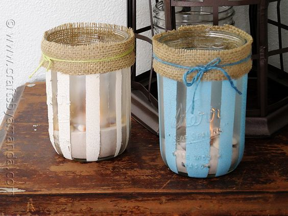 DIY Striped Beach Luminaries. Give your table or deck a touch of the beach with these easy to make luminaries filled with sand and shells.