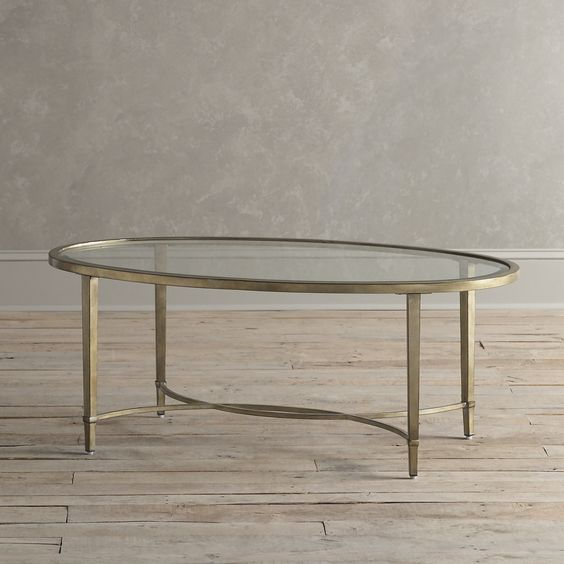 Birch Lane Horton Coffee Table - An elegant centerpiece for any room, this oval coffee table features a brushed antique silver finish and beveled, clear tempered glass with metal tubing and levelers.
