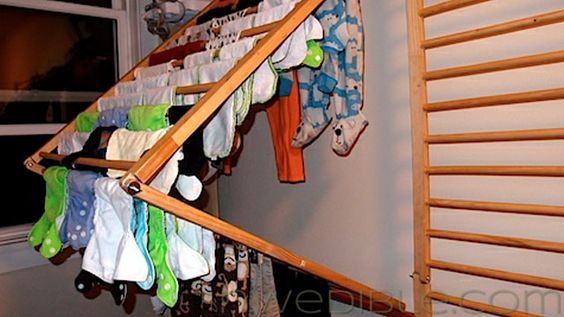 DIY Wall-Mounted, Folding Clothes Dryer Rack using baby corral.