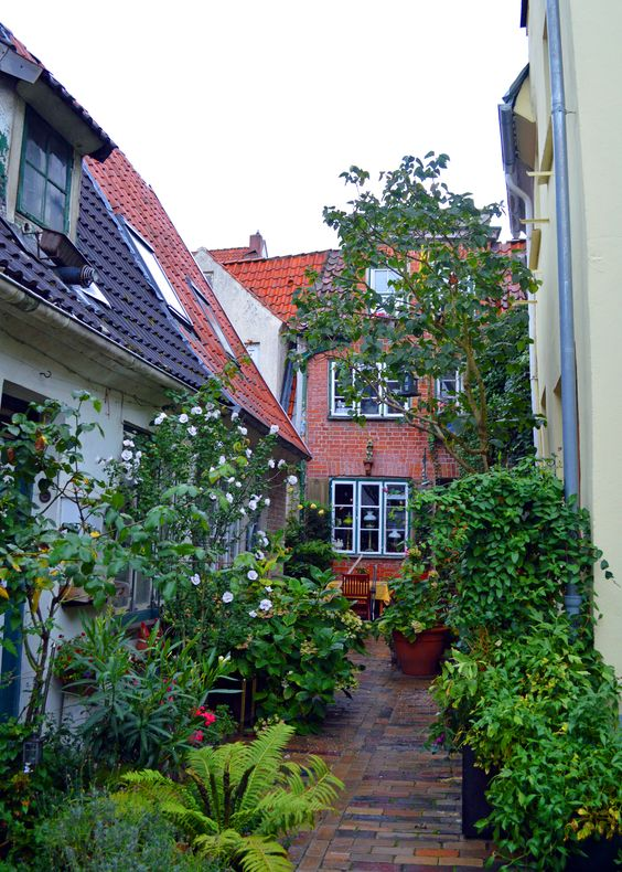 narrow alleyways lined with tiny houses lubeck germany pinterest house tiny house and. Black Bedroom Furniture Sets. Home Design Ideas