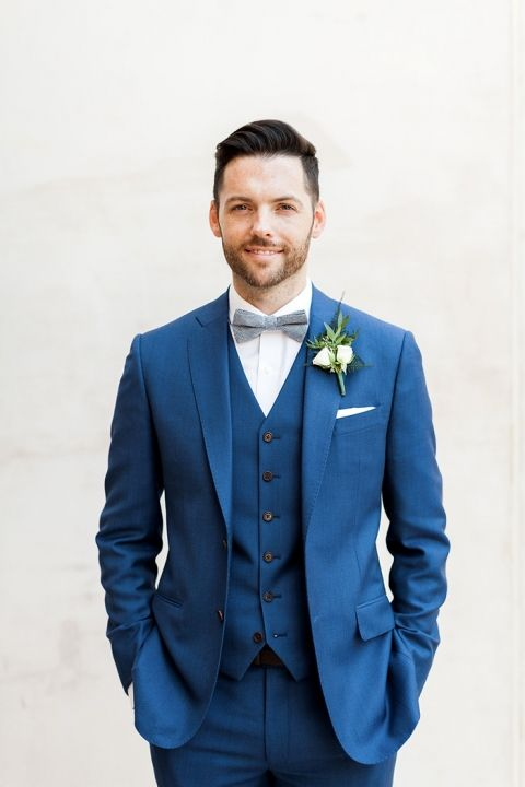 Groom in a Navy Blue Three Piece Suit