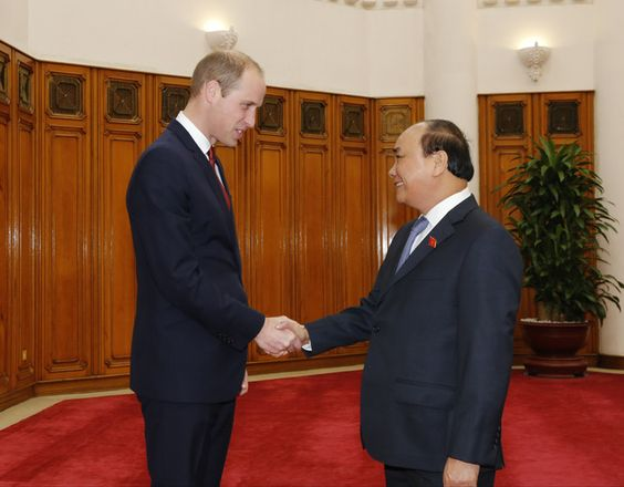 Britain's Prince William, left, shakes hands with Vietnamese Prime Minister Nguyen Xuan Phuc in Hanoi, Vietnam, Wednesday, Nov. 16, 2016. The Duke of Cambrid...