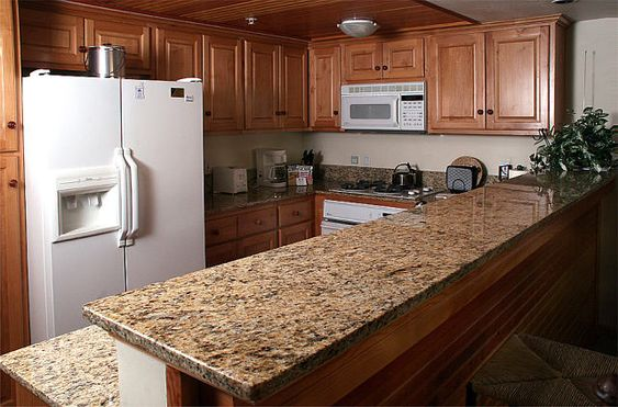 Medium wood tones create a slightly darker tone, but in a beautiful way. You draw out some of the brown in the giallo veneziano granite but still have plenty of light to go with it.