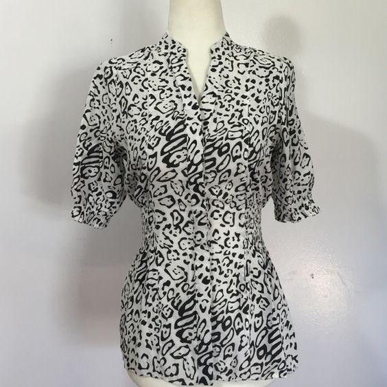 BCBGMAXAZRIA Lightweight Cheetah Button Diwn- XS Beautifully taperd blouse with elasticized waist & sleeves- viscose/ nylon blend- very lightweight! Like new BCBGMaxAzria Tops Blouses