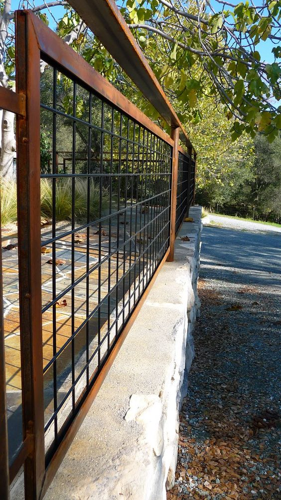 Living iron hog wire fencing with patina landscape