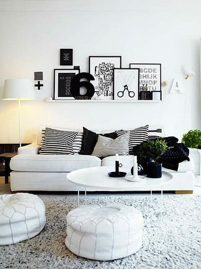 Love the layered art shelf in this modern black and white living room--you can add different colored accessories with the changing seasons while keeping it modern.: