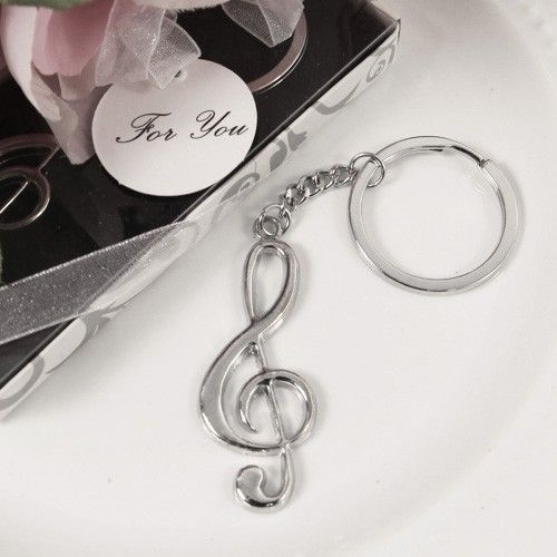 """Thank your guests with the Harmony Treble Clef Key Chain music favors, a token of appreciation that transcends language. This whimsical music party favor celebrates the memorable coming together of friends and family. Sing loudly and proudly with your loved ones on this special day.Measurements: 4 1/4""""L Comes in a white gift box with flourish pattern and plastic cover. Gift box is tied with a white organza ribbon bow and adorned with a """"For You"""" gift tag"""