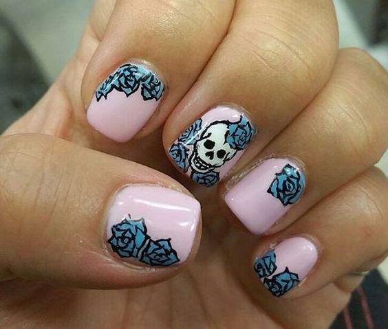 Girly Halloween nails! #manicure #naildesign #nailart #skulls #pink #blue #roses
