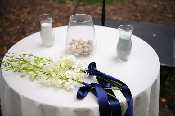 White orchid wedding bouquet with blue accent ribbon, photo by Kenny Nakai Photography