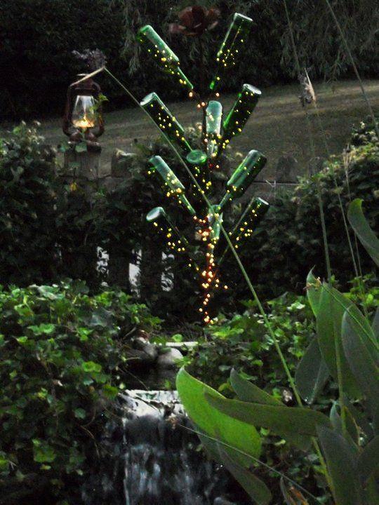 Bottle tree with lights looks like fireflies