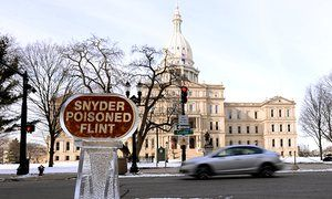 An ice sculpture that reads 'Snyder Poisoned Flint' stands outside Governor Rick Snyder's office in Lansing, Michigan.