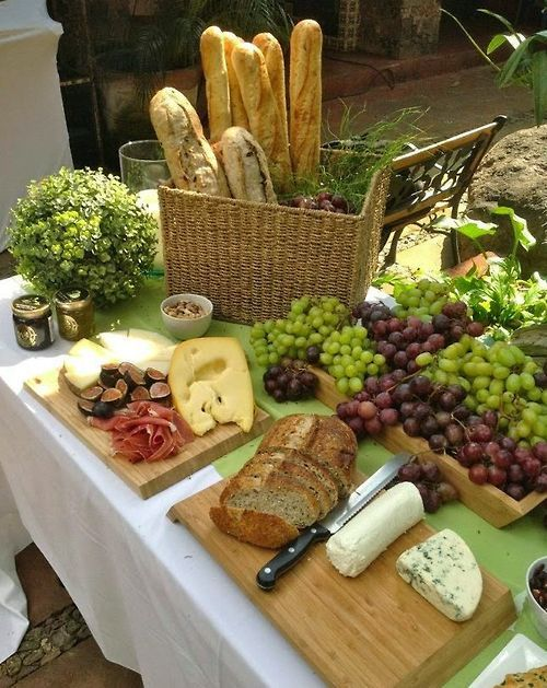 artfully rustic tablescape ... cheese, bread, fruits ... yum