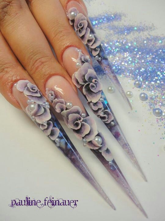 Not a fan of the style and shape of the actual nail...but love the designs on stiletto nails !!