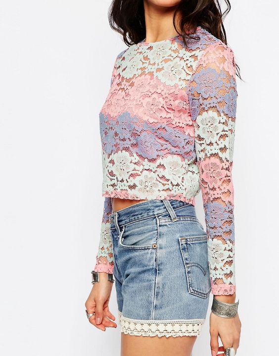 River Island Pastel Lace Top. Lined lace. Semi-sheer finish Round neckline. Cropped cut Button keyhole back. Regular fit - true to size. Machine wash. 58% Nylon, 26% Cotton, 16% Polyester